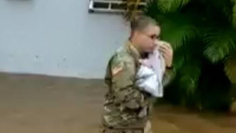 Puerto Rico national guard rescue a baby from flooding