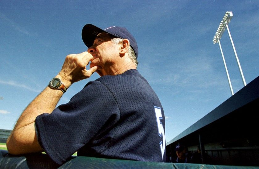 Angels coach Sam Suplizio watches from the dugout as the Angels take on the Oakland Athletics in 1998.