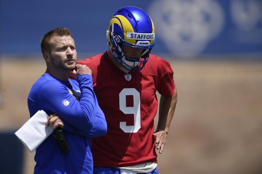 Los Angeles Rams head coach Sean McVay, left, speaks with Matthew Stafford during NFL football practice in Thousand Oaks, Calif., Thursday, May 27, 2021. (AP Photo/Kelvin Kuo)