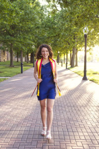 Smiling girl with a graduation stole