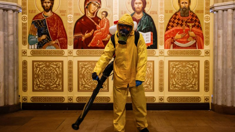 A specialist sanitizes a railway station amid the outbreak of the coronavirus disease in Moscow