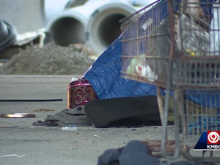 Groups of people leave trash, clothes, other items nearby Kansas City's Just Off Broadway Theatre